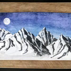 Luna Llena entre montañas